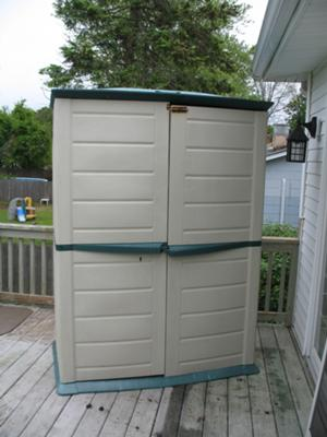 front of shed with hole