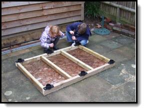 Adjustable shed foundation - plastic jacks